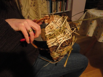 Picking off the excess material where the joins occur on the outside of the basket.